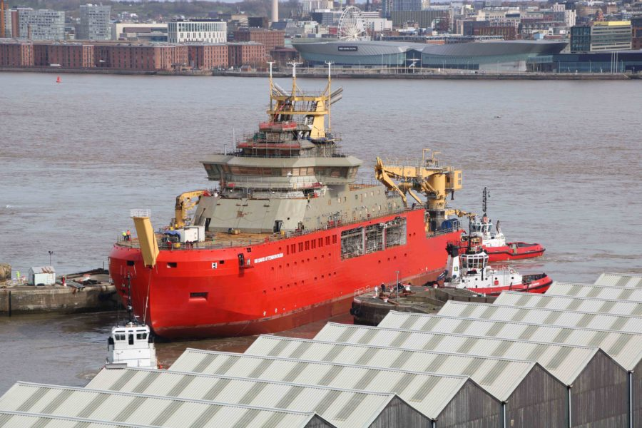 The RRS Sir David Attenborough being guided into the wet basin at Cammell Laird Shipyard in Birkenhead- Daily Logistucs